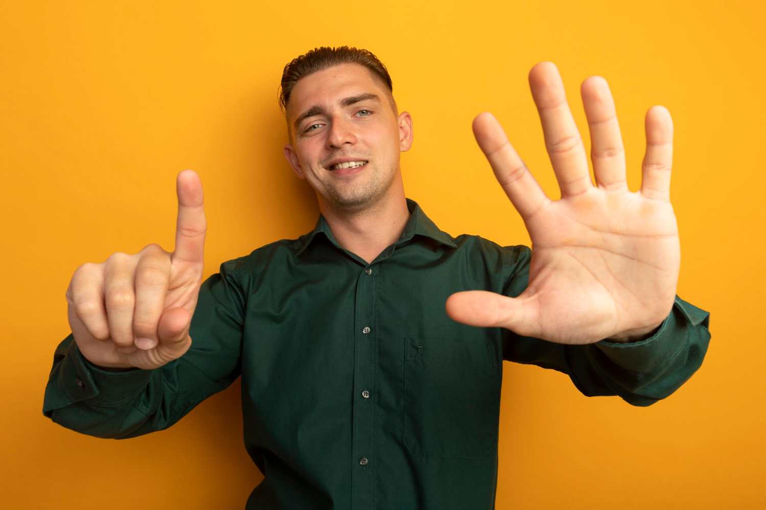 Man holding up six fingers to indicate the six myths about voip