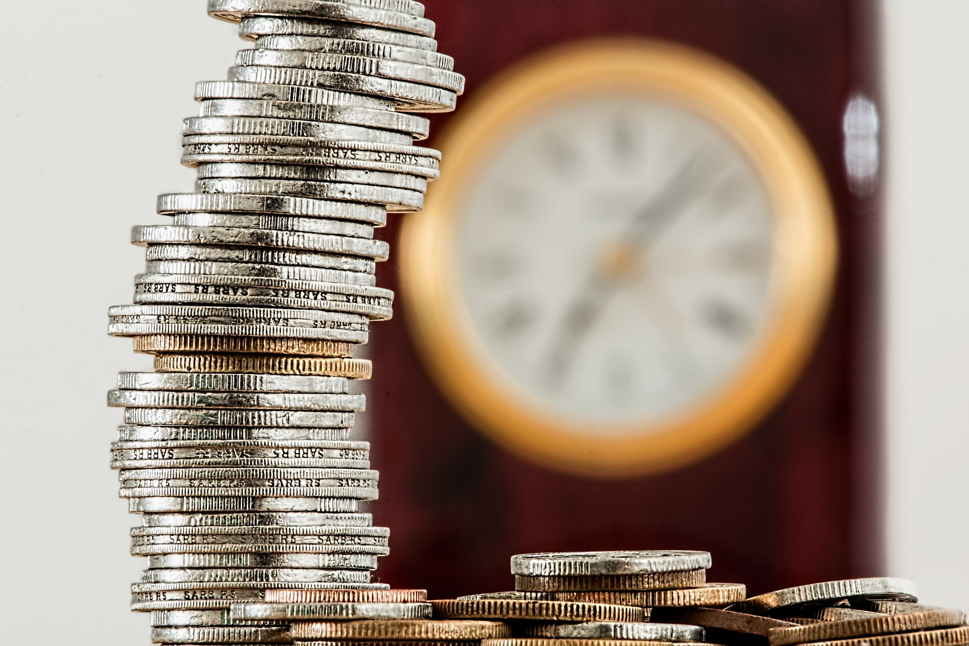 A close up of a stack of coins symbolizing how voip solutions can help save you money